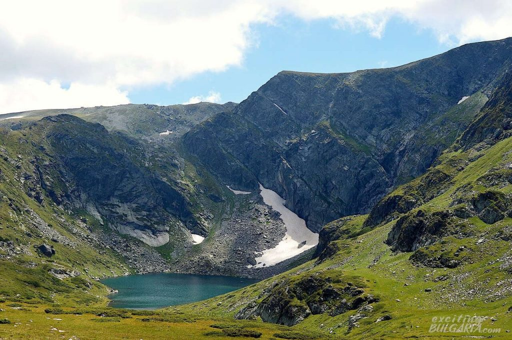 Panorama of the Rila mountain range with a lake
